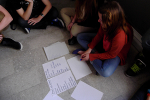 Students working in groups to create a list of Key Phrases for the final web based publication